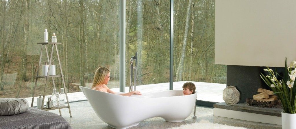 Photo of bathroom with bathtub and people bathing inside